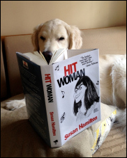 "Wilson the dog with his copy of ""Hit Woman"""