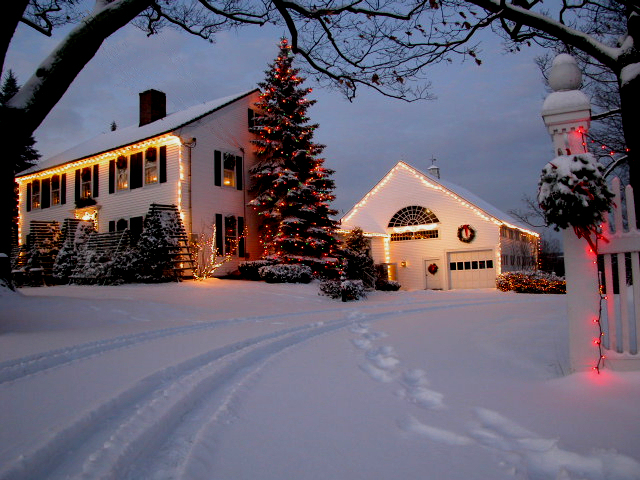 An Irving Berlin Christmas look with the house all lit up in the snow